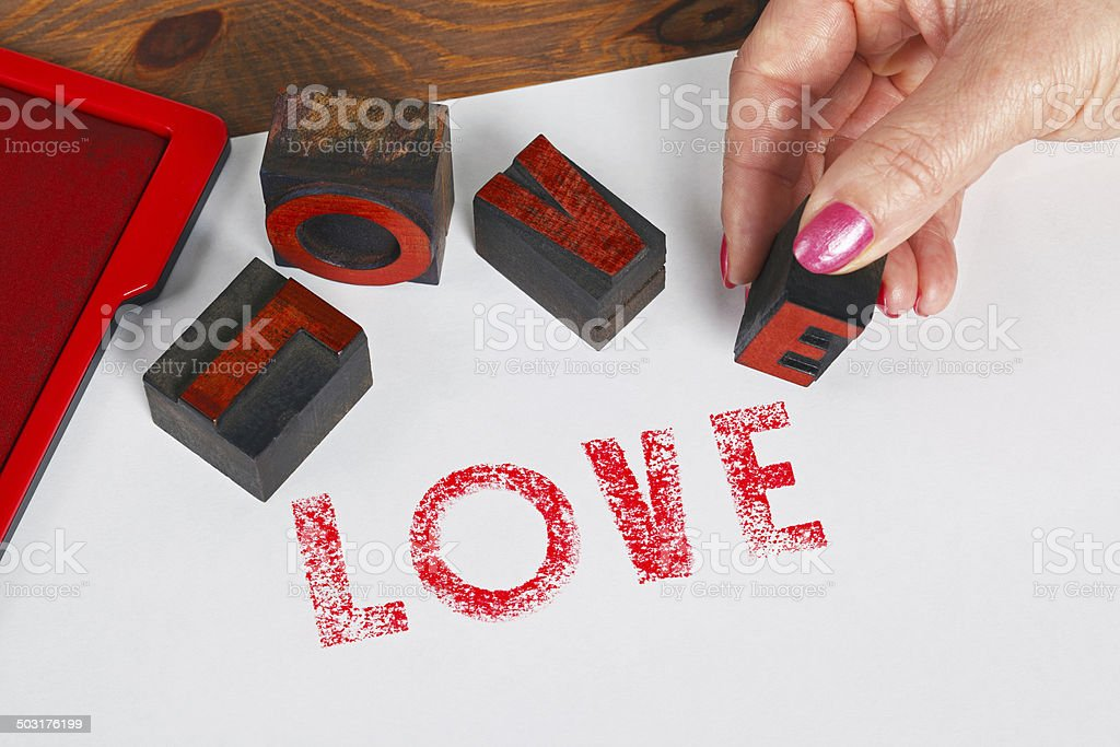 The word LOVE using wooden letterpress stock photo