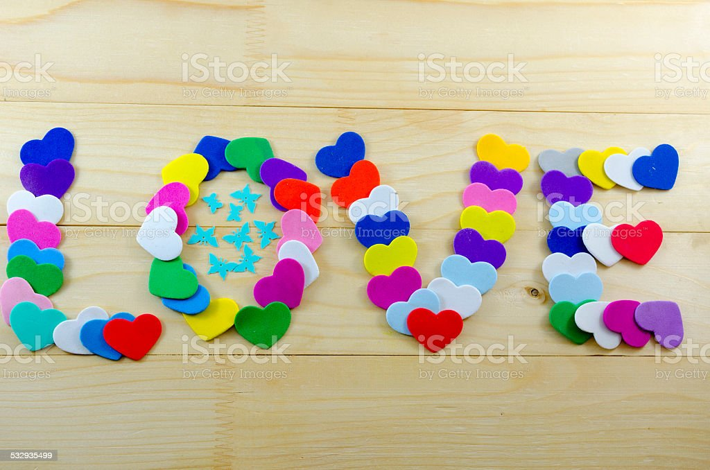 The word love written with cardboard hearts royalty-free stock photo