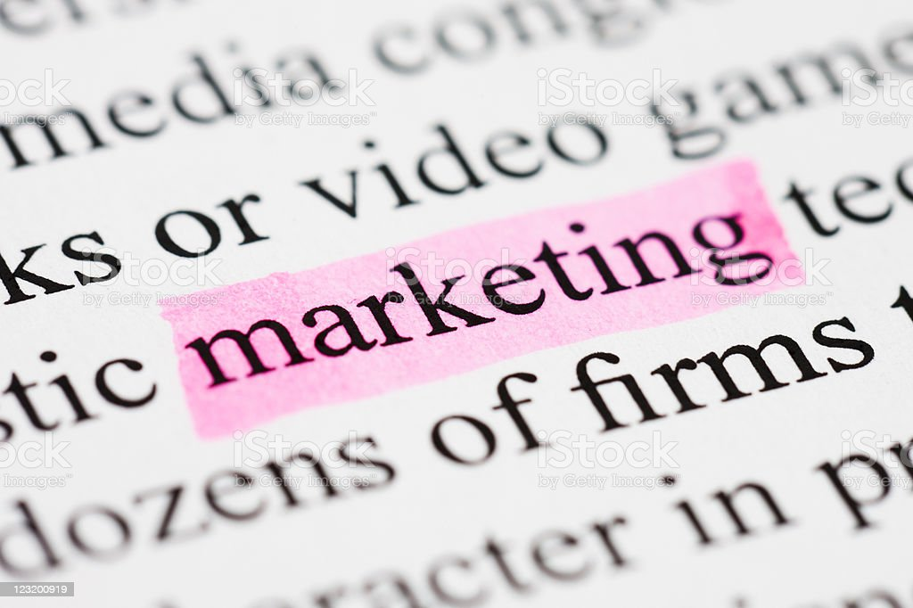 The word marketing is highlighted in pink on printed text royalty-free stock photo