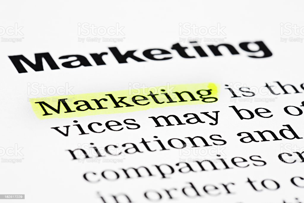 The word 'Marketing' is highlighted in yellow on a page royalty-free stock photo