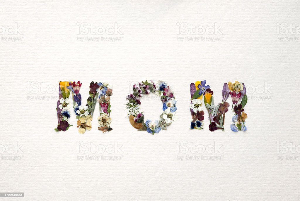 The Word Mom Written with Flowers stock photo