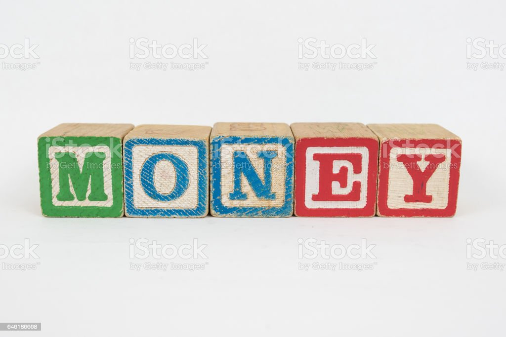 The Word Money in Wooden Childrens Blocks stock photo