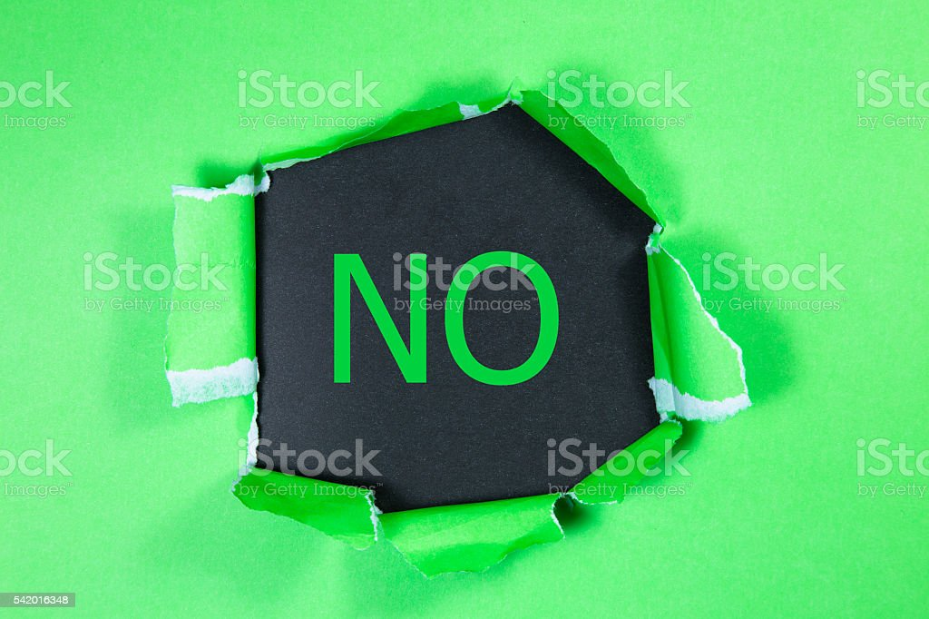 The word NO written under torn paper. stock photo