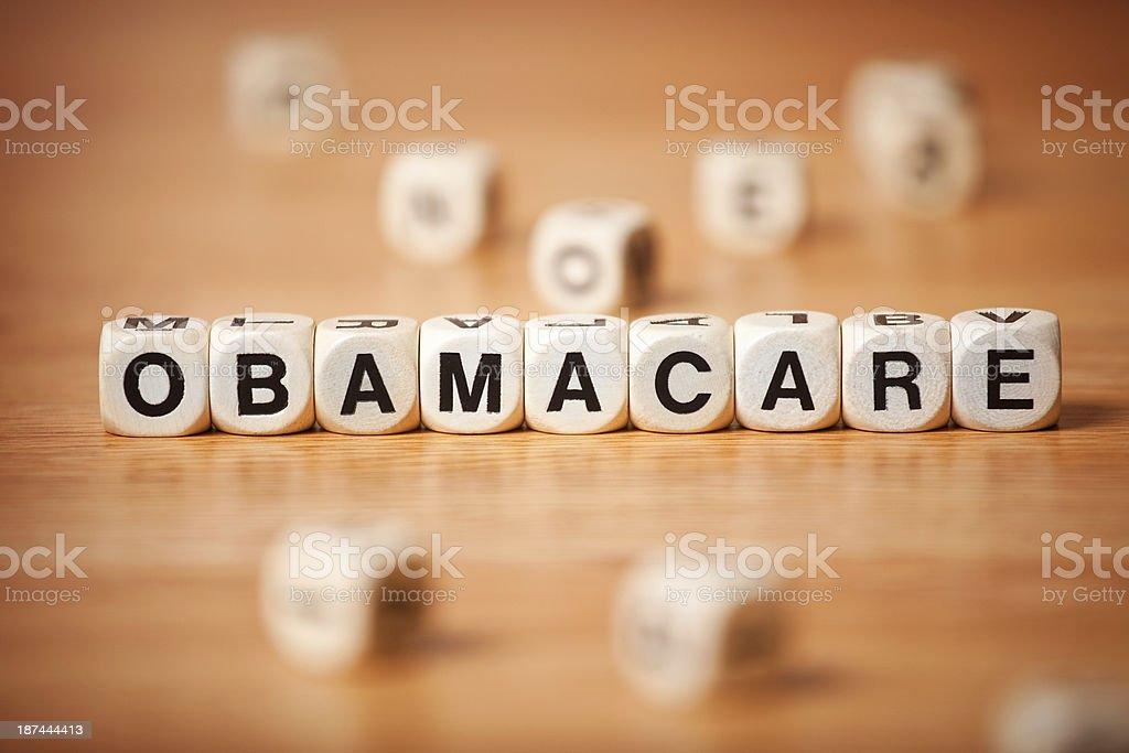 The Word OBAMACARE Spelled In Letter Cubes royalty-free stock photo