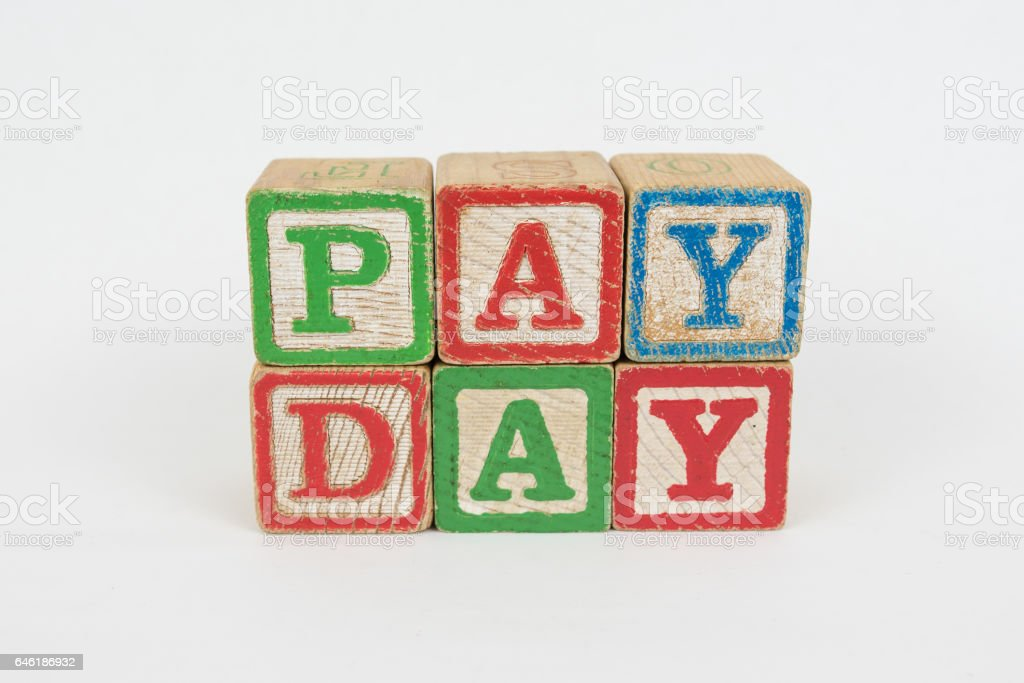 The Word Pay Day in Wooden Childrens Blocks stock photo