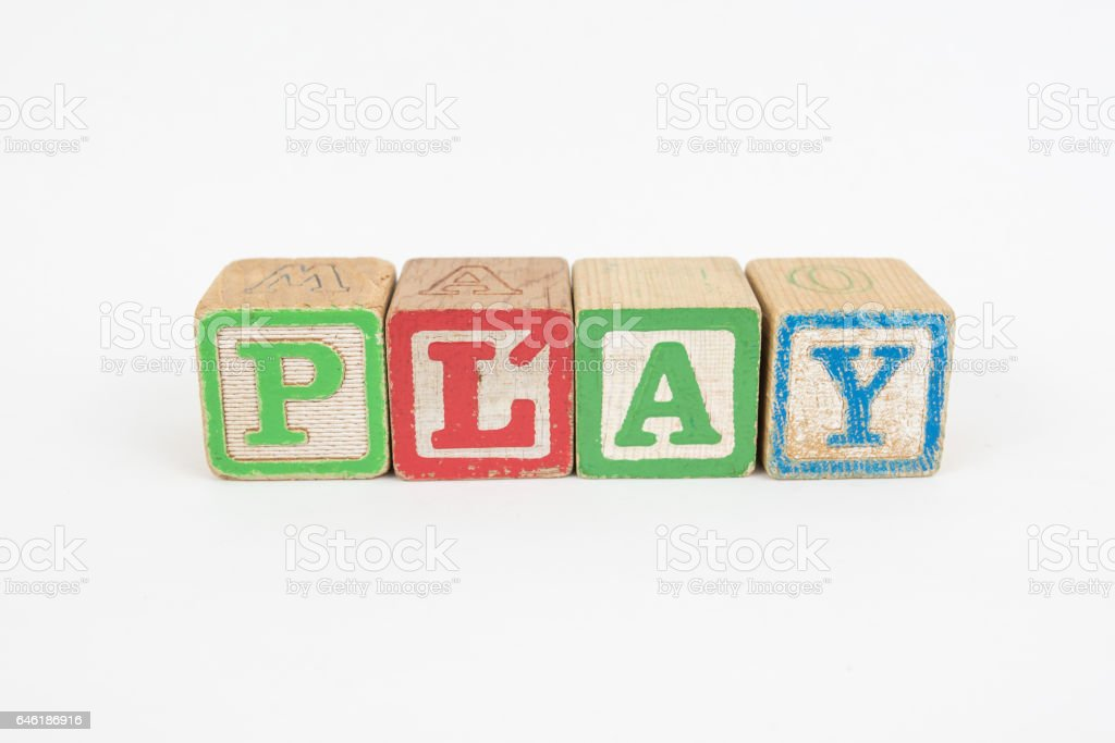 The Word Play in Wooden Childrens Blocks stock photo