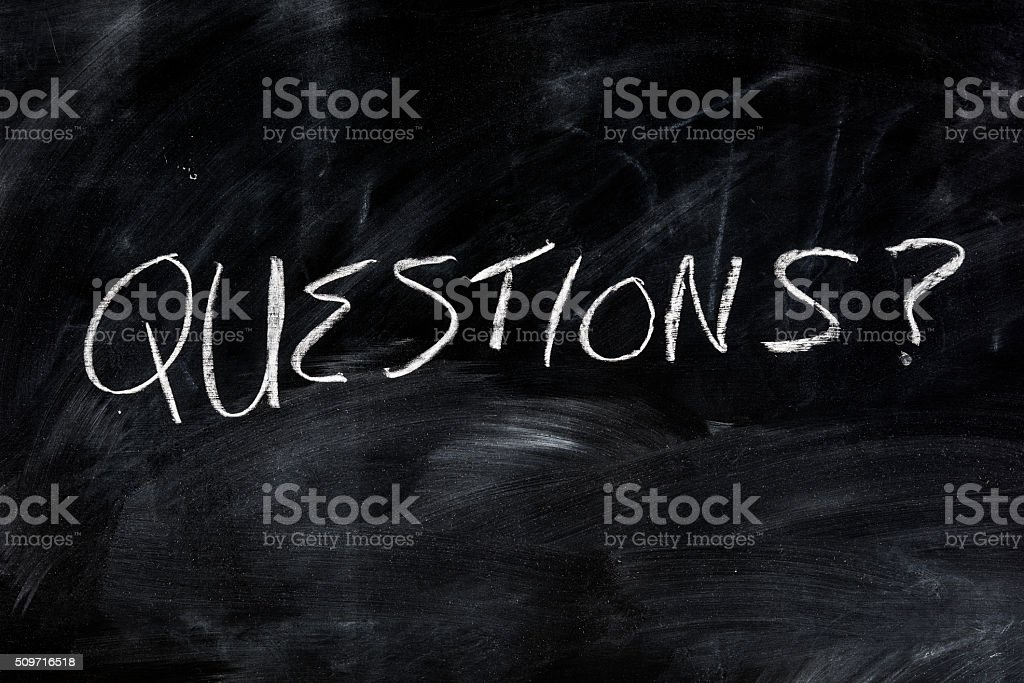 The word questions, written on a chalkboard stock photo