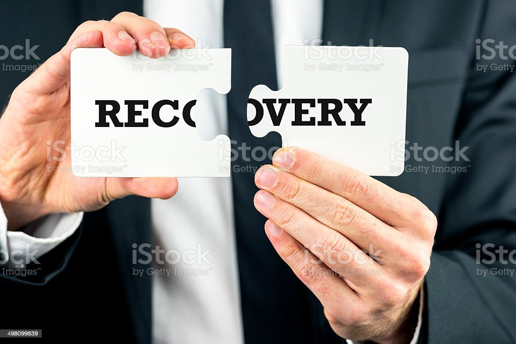 The word Recovery on puzzle pieces stock photo