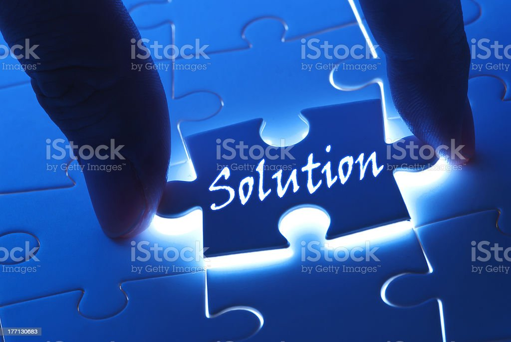 The word solution being placed into the puzzle royalty-free stock photo