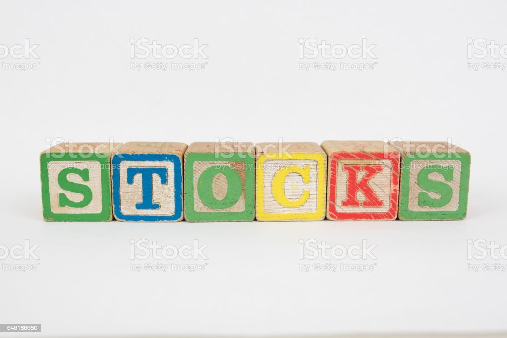 The Word Stocks in Wooden Childrens Blocks stock photo