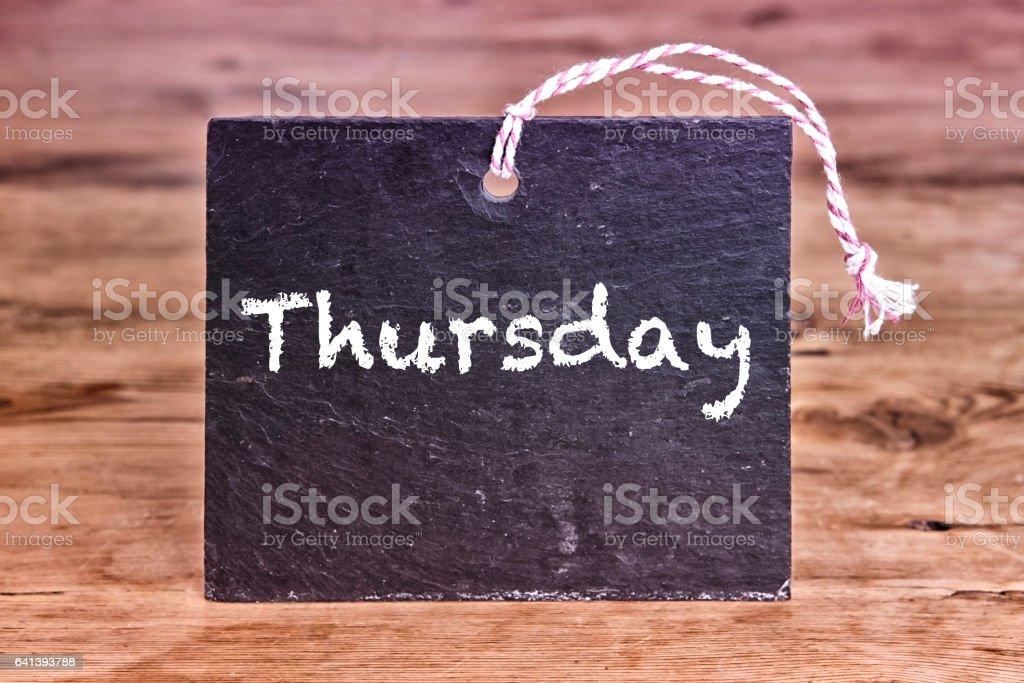the word Thursday written on chalk board stock photo