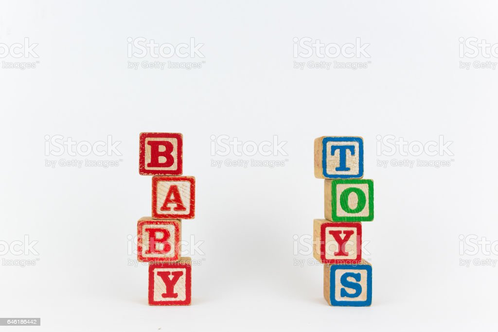 The Word Toy and Baby in Wooden Childrens Blocks stock photo
