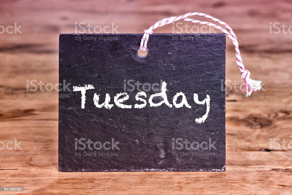 the word Tuesday written on chalk board stock photo