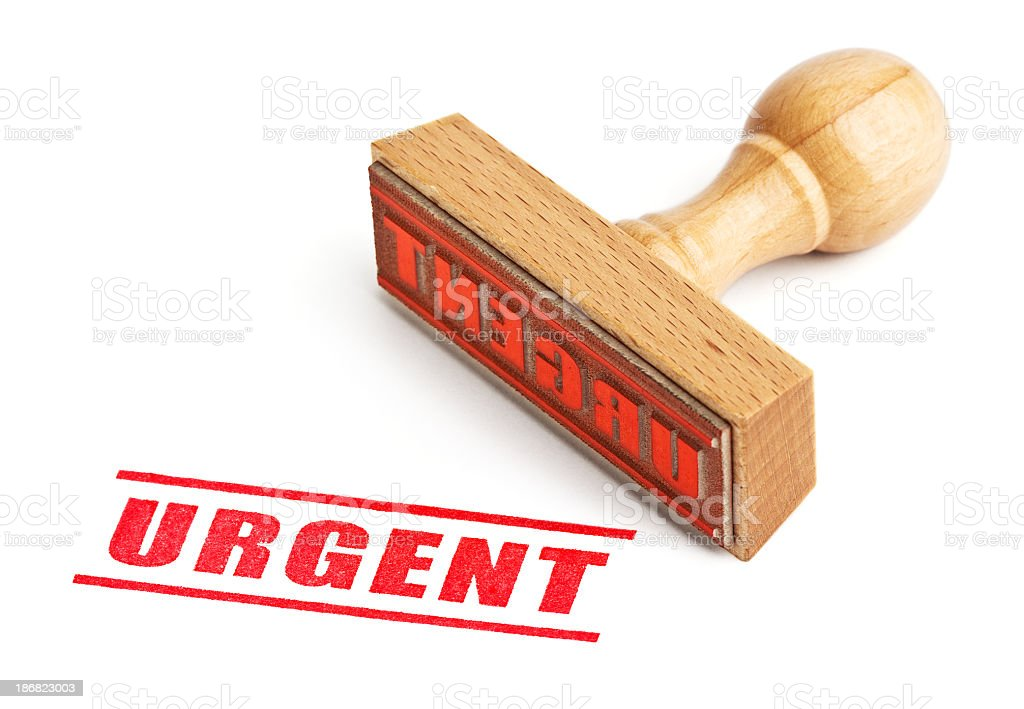 The word urgent stamped in red with the stamp laying nearby stock photo