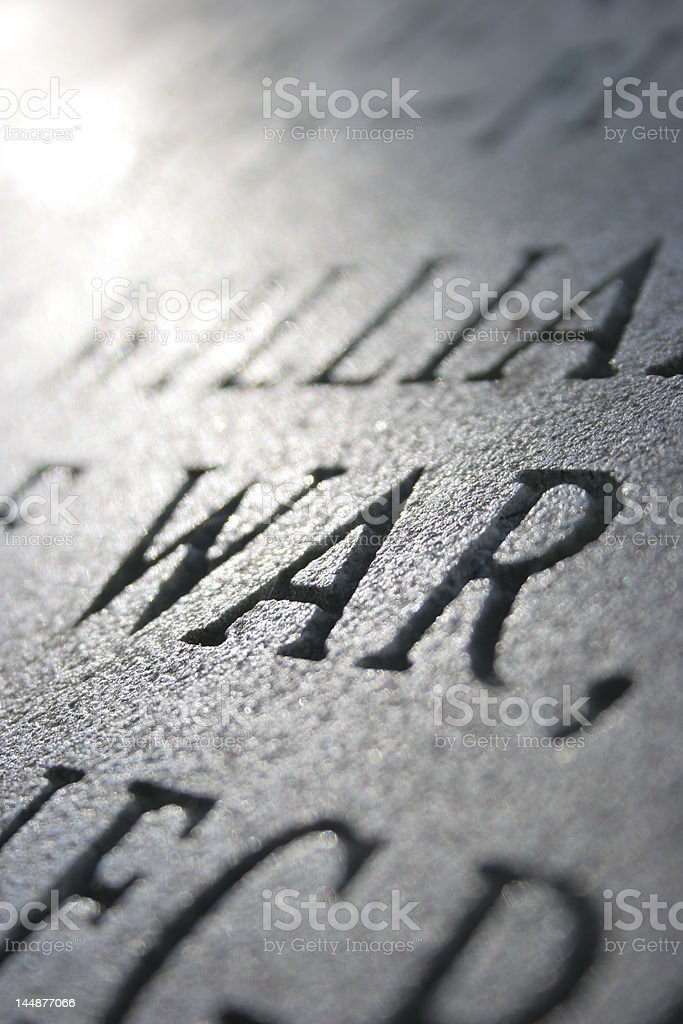 The word WAR carved into stone royalty-free stock photo