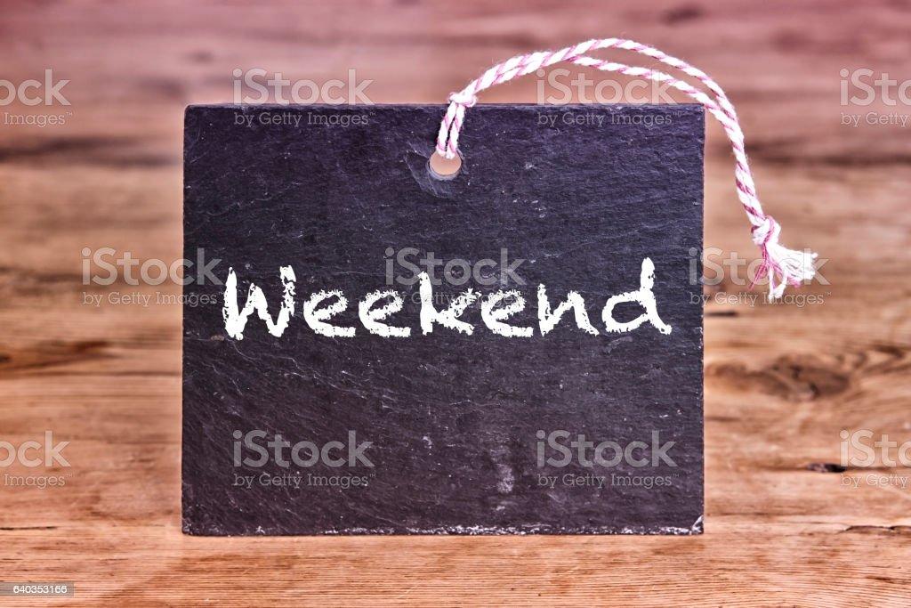 the word weekend written on chalk board stock photo