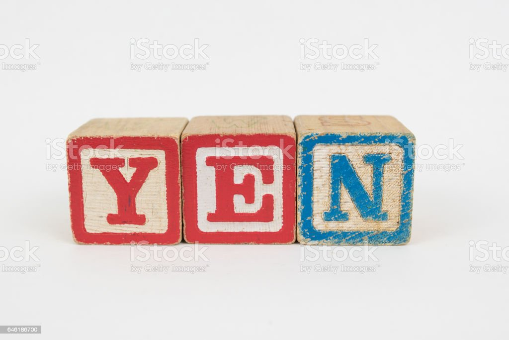 The Word Yen in Wooden Childrens Blocks stock photo