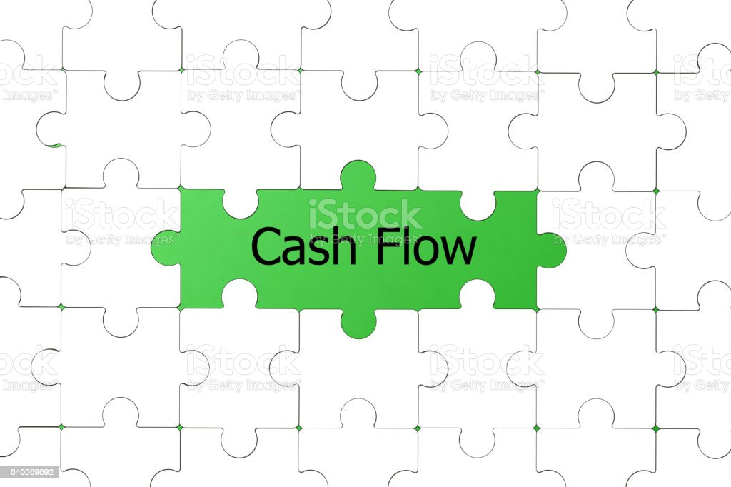 The words Cash Flow missing jigsaw puzzle piece stock photo