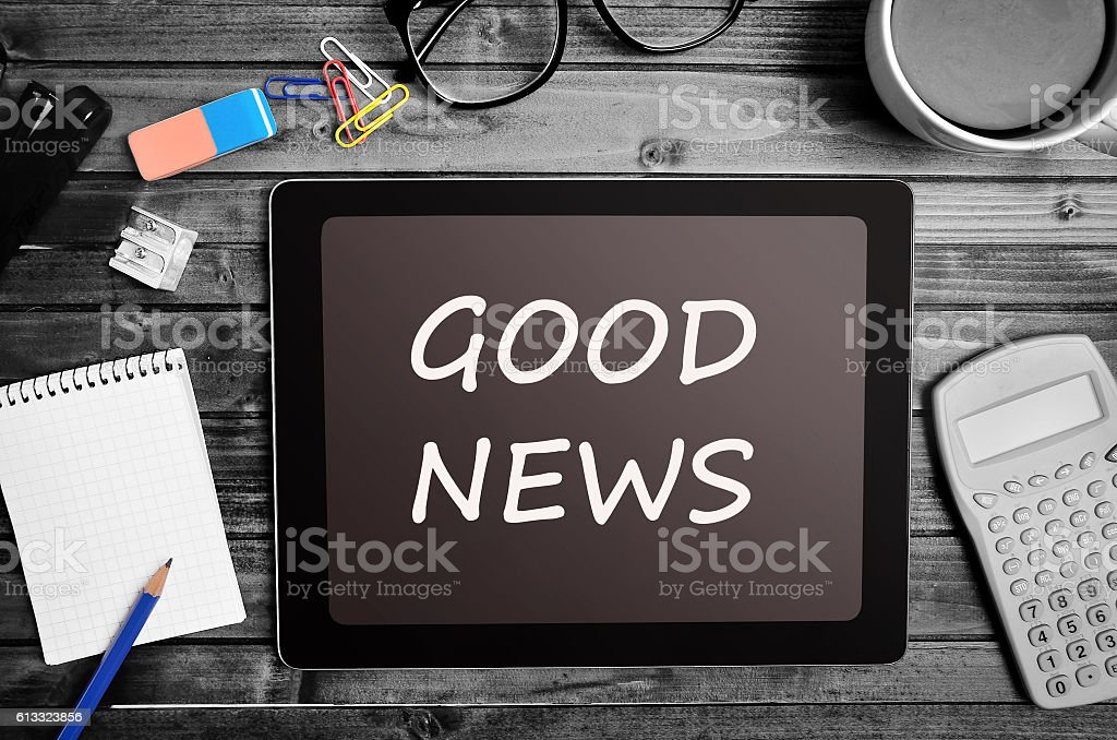 The words Good News on tablet stock photo