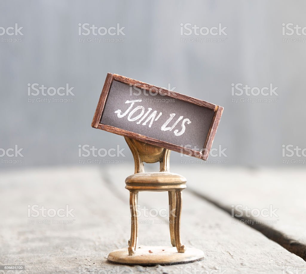 The words JOIN US and chair. Job recruiting. stock photo