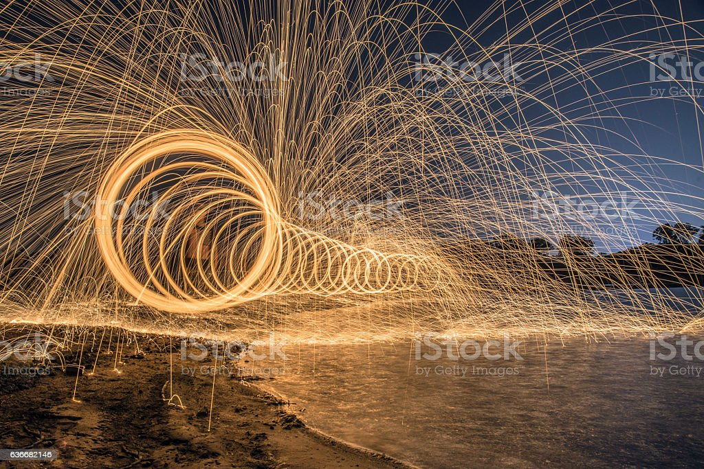 The work of glowing sparks from spinning steel. stock photo