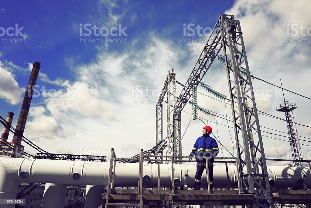 The worker at power plant.Industrial background. stock photo