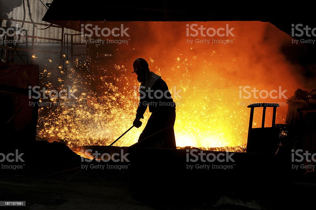 The worker in front of blast furnace stock photo