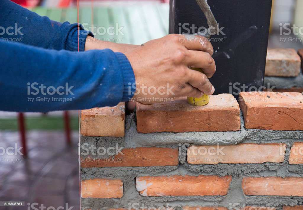the worker is masoning the brick stock photo