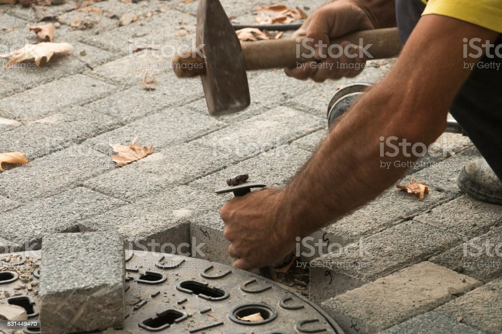The worker is working on a stone stock photo