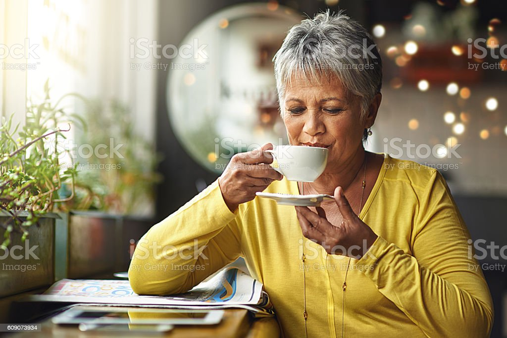 The world starts moving after my coffee stock photo
