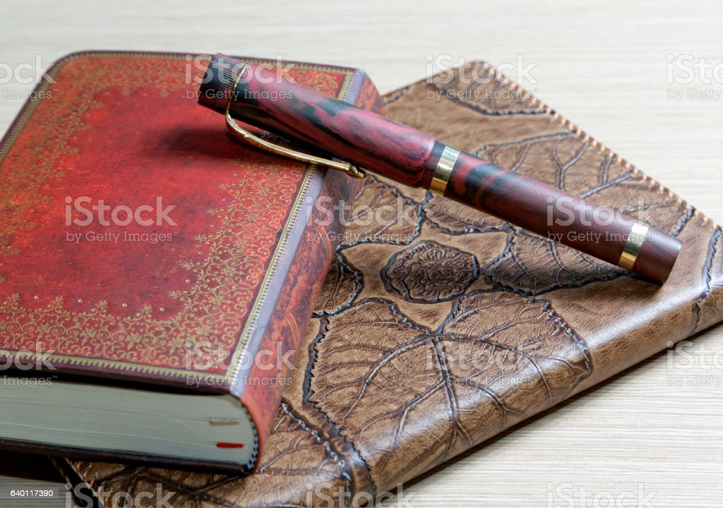 The  writing-book in a leather cover and  pen stock photo