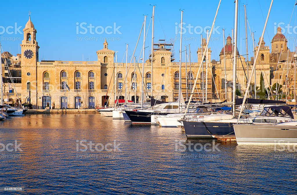 The yachts moored in the harbor in front of Malta stock photo