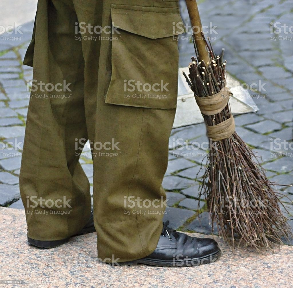 The yard keeper with a whisk stock photo
