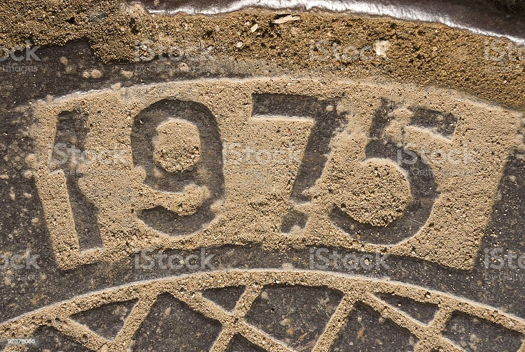 The year 1975 engraved in stone stock photo