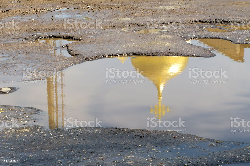 The yellow (gold) dome of the Church with the cross stock photo