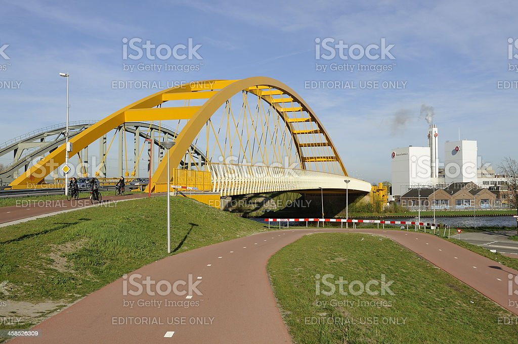 The yellow 'Hogeweidebrug' in Utrecht royalty-free stock photo