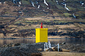 The yellow light house of Eskifjordur, East Iceland.