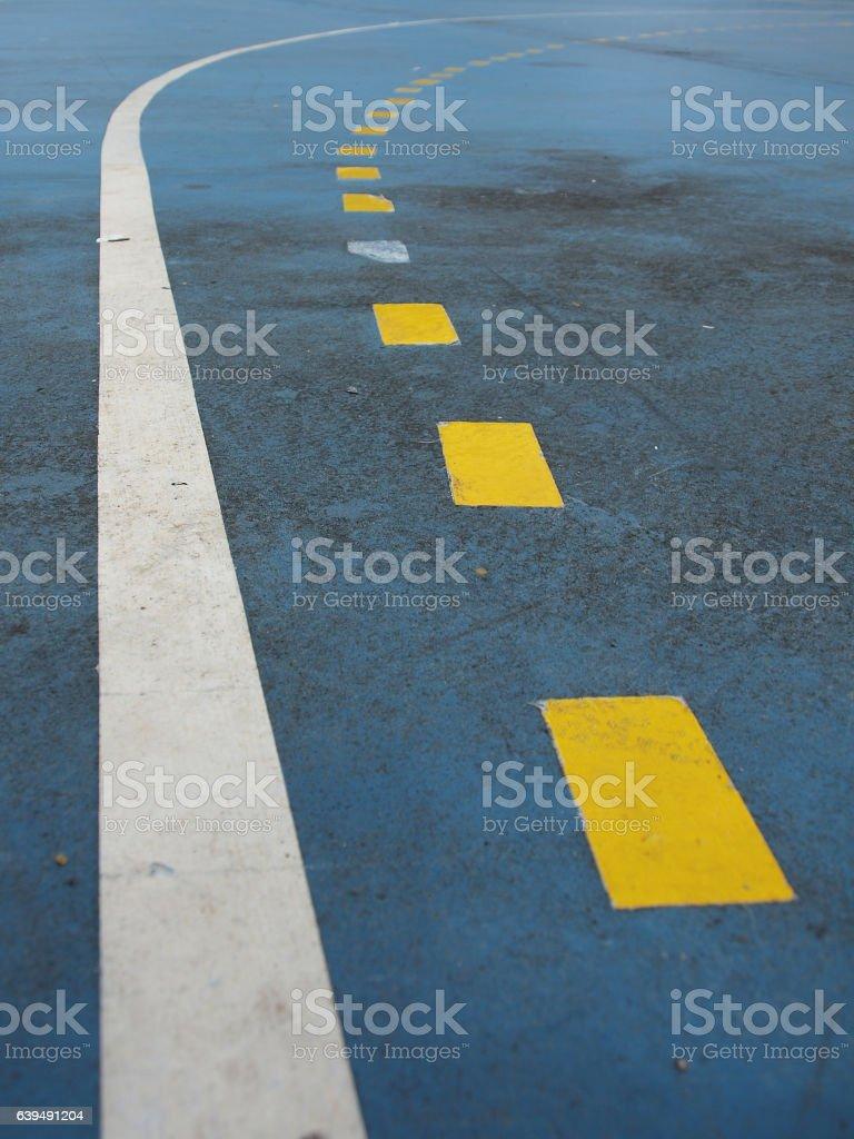 The yellow line on blue floor stock photo