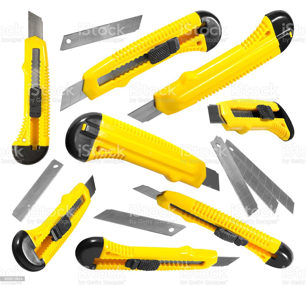 The yellow stationery knifes isolated on white background stock photo