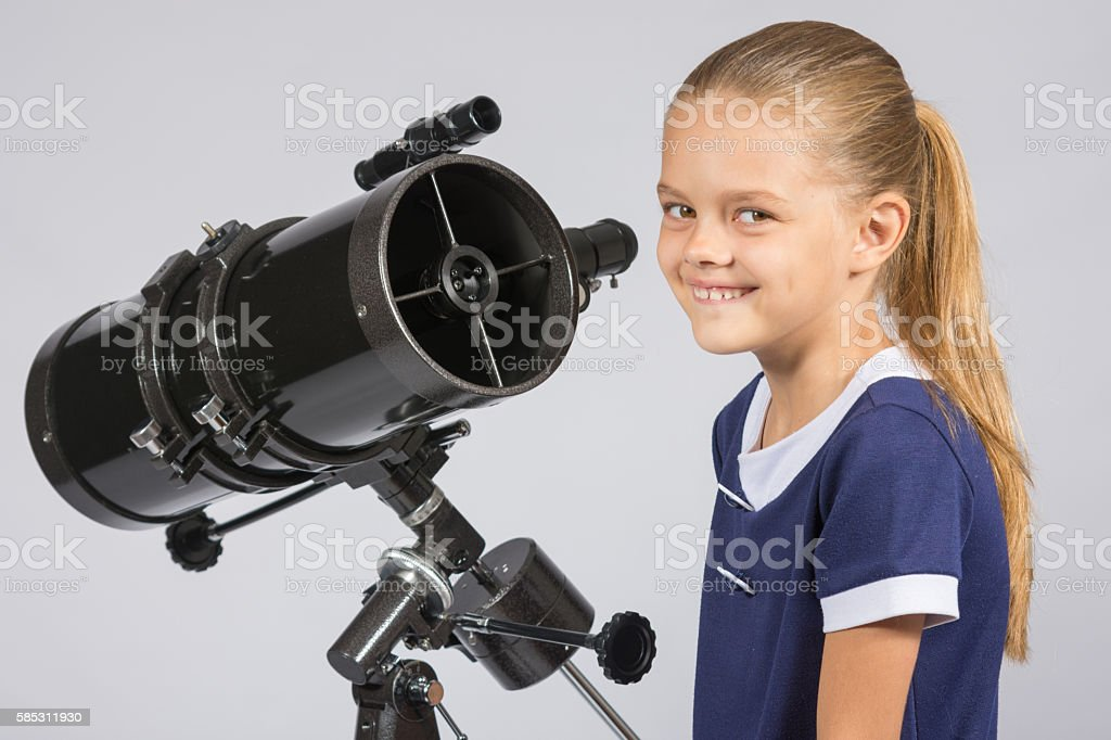 The young astronomer at the telescope is smiling stock photo
