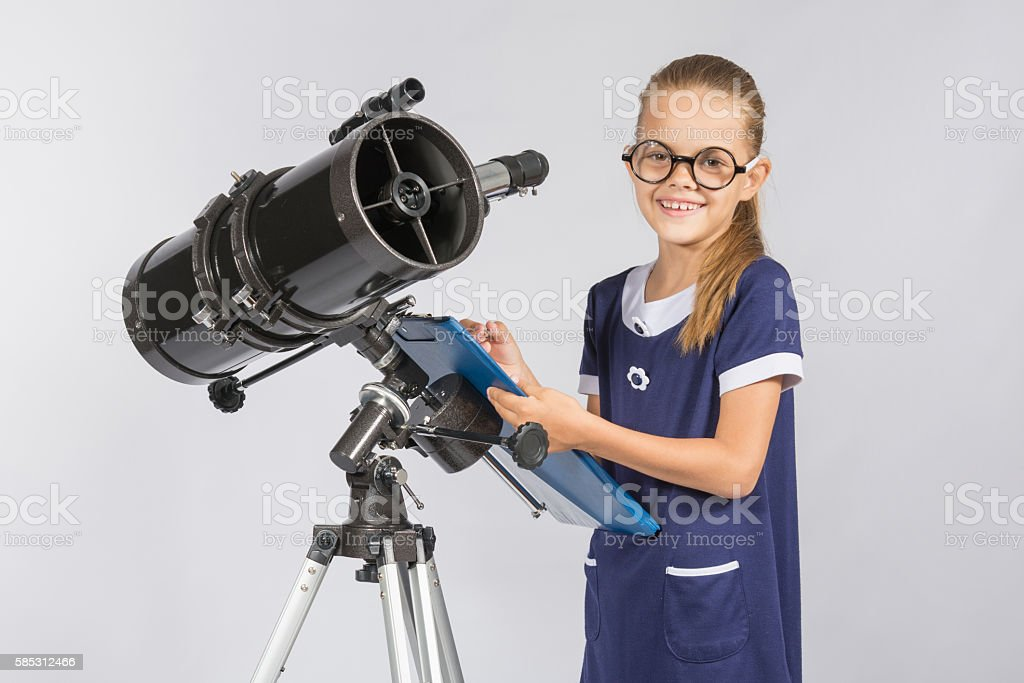The young astronomer happy to look through the telescope stock photo