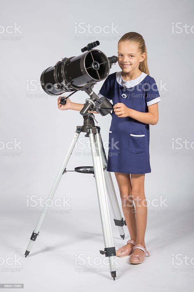 The young astronomer sets up a telescope stock photo