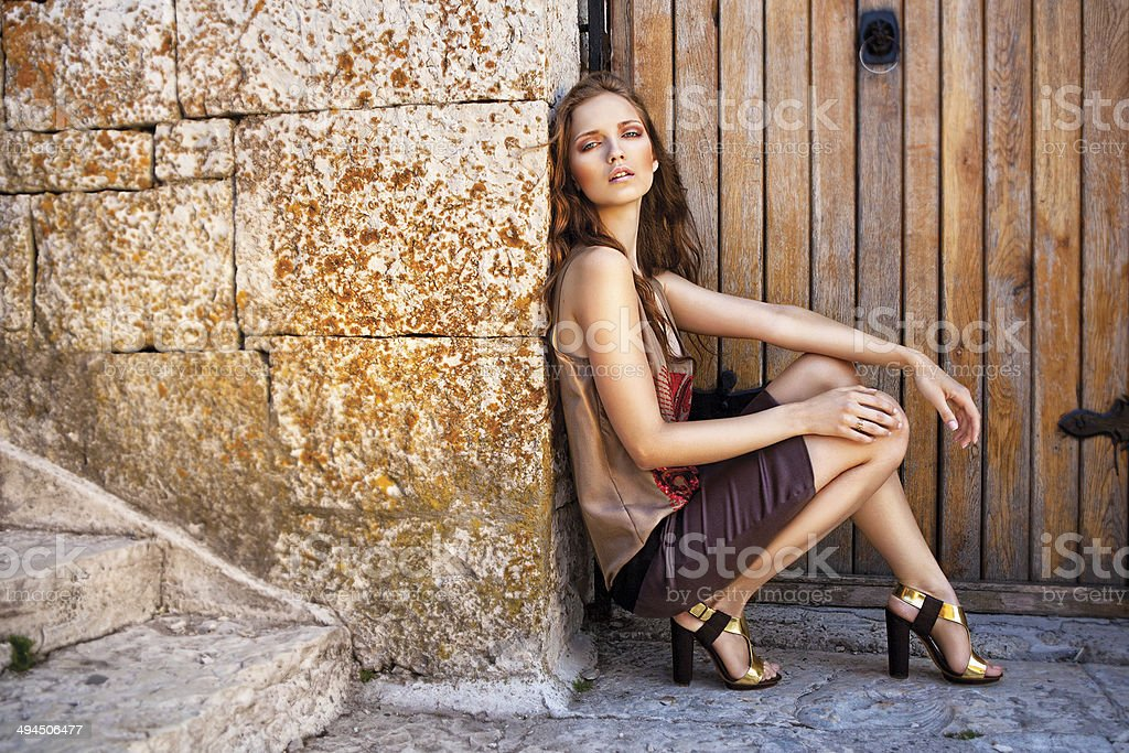 The young beautiful girl in gold shades royalty-free stock photo