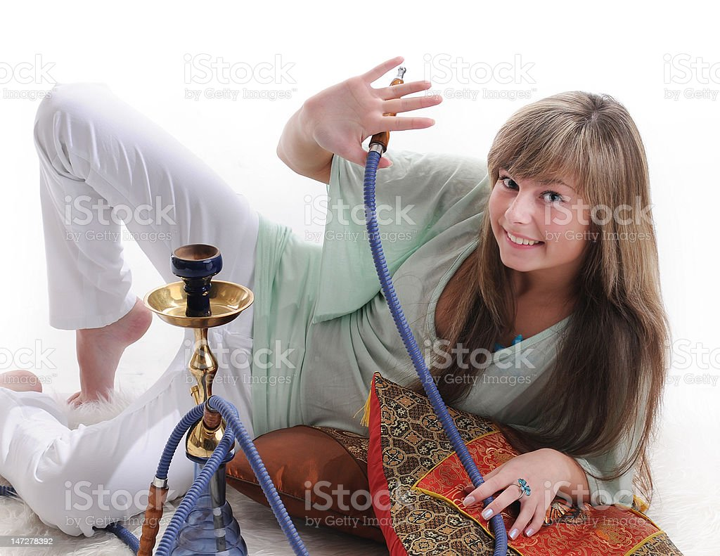 The young beautiful girl with a hookah royalty-free stock photo