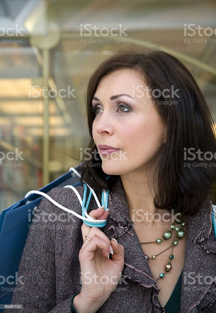 The young beautiful woman with purchases in stor royalty-free stock photo
