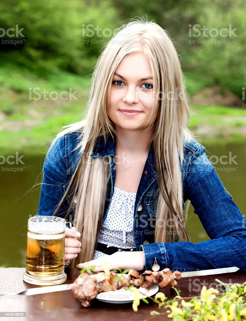 The young blue-eyed blonde. stock photo