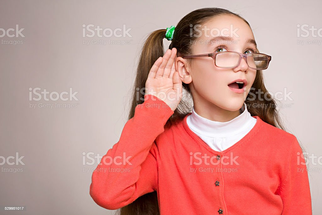 The young girl listening to gossip stock photo