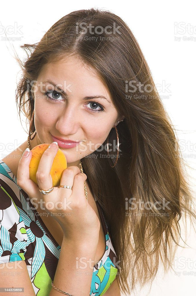 The young girl with a peach royalty-free stock photo