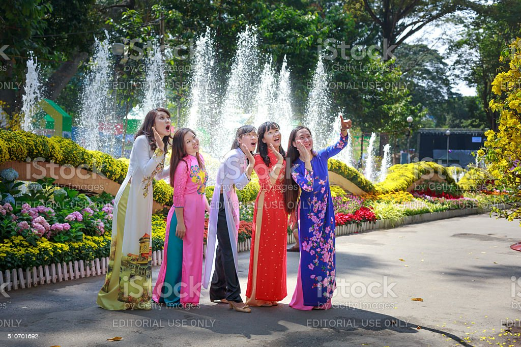 the young girls wearing traditional dress in a flower festival stock photo