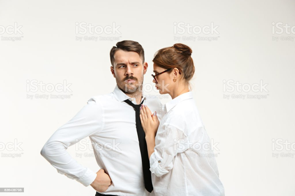 The young man and beautiful woman in business suit at office on white background stock photo